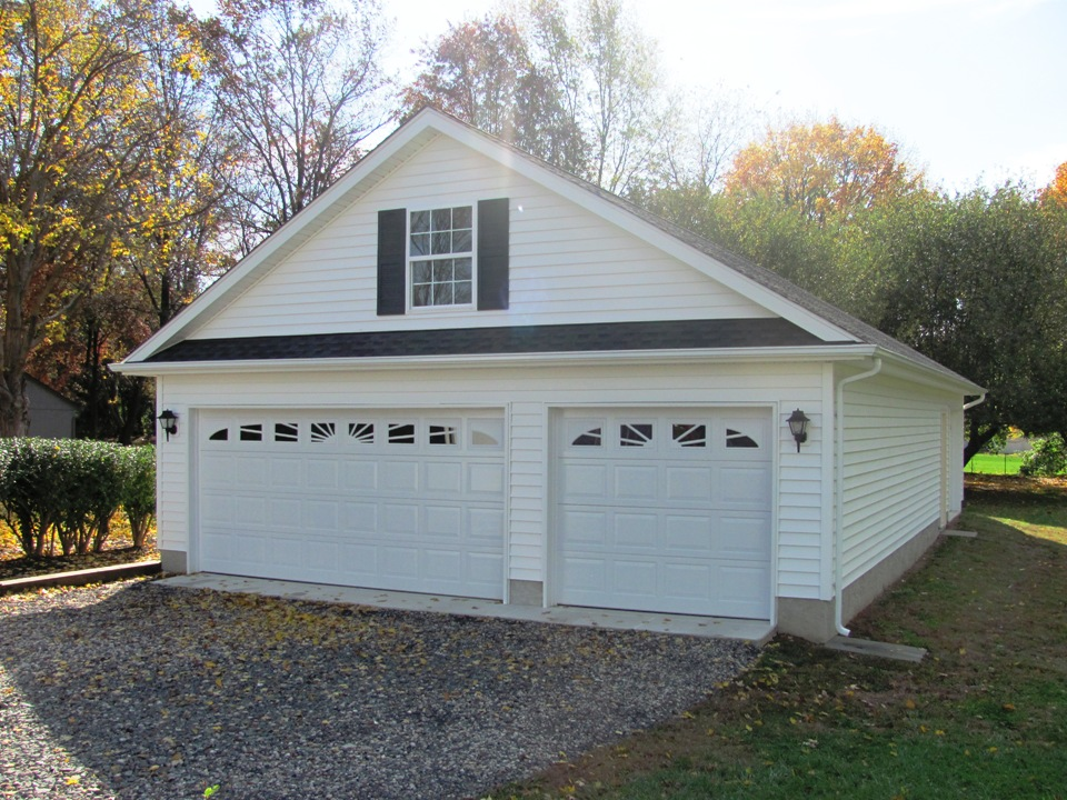 2 1 2 car or larger garages garages by opdyke for One car garage with carport