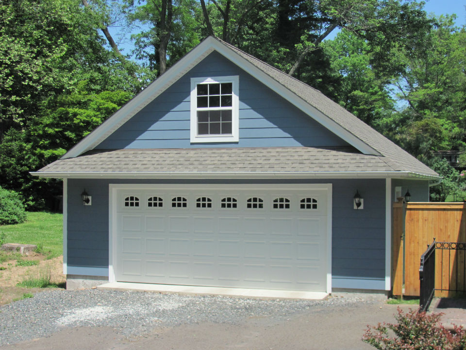 2 car garages garages by opdyke for Garage plans with storage